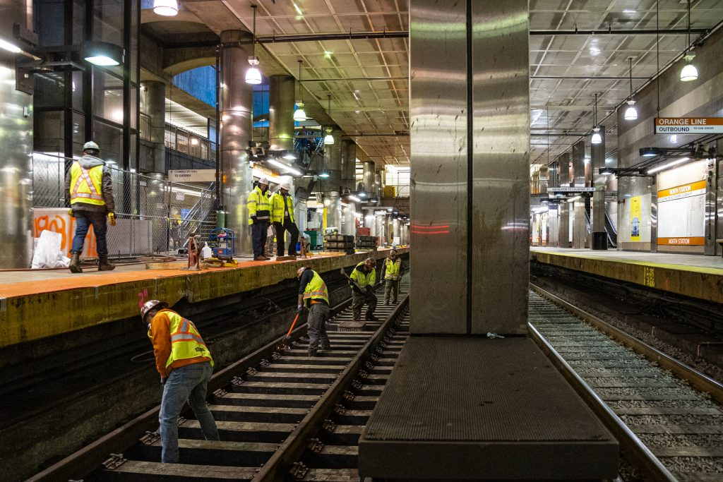 Construction Workers on Orange Line Track