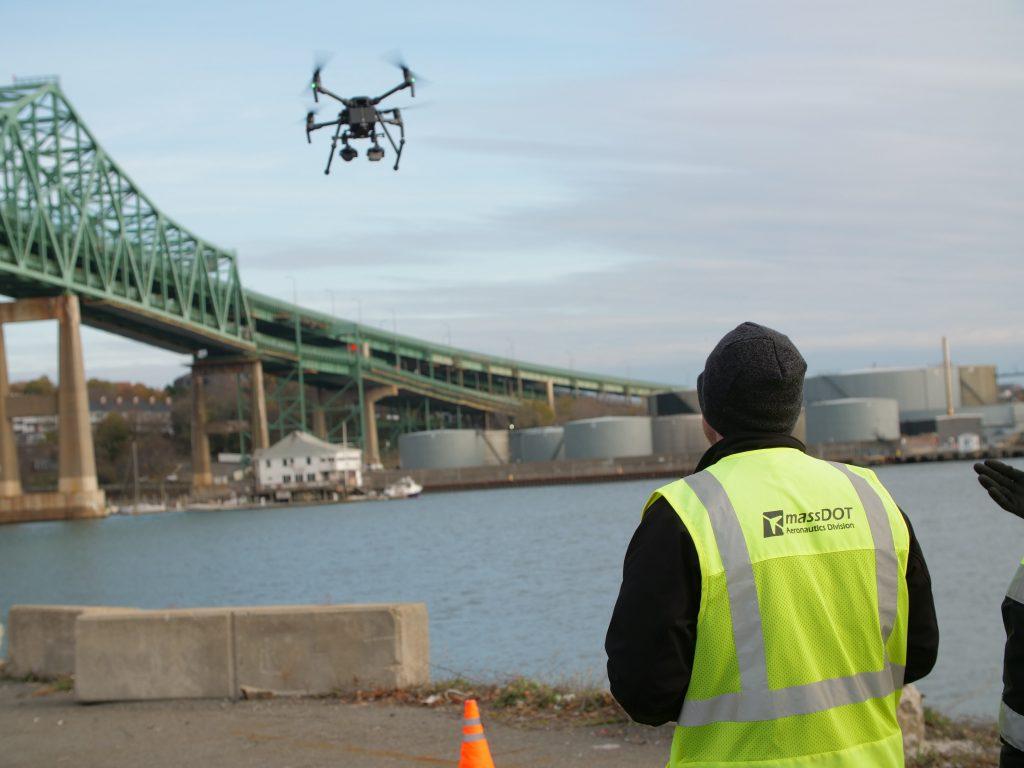 Aeronautics Employee Flying Drone Over Water